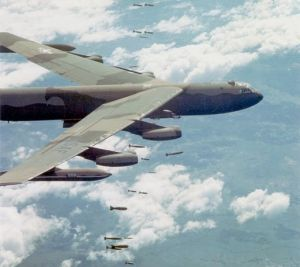 "A U.S. Air Force Boeing B-52D-35-BW Stratofortress (s/n 52-669) dropping bombs over Vietnam. This aircraft was hit by SA-2 surface-to-air missile over North Vietnam during the ""Linebacker II"" offensive on 31 December 1972 and crashed in in Laos. The crew of six ejected, but only five were rescued. By USAF [Public domain], via Wikimedia Commons"