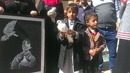 A_blind_child_carries_a_dove_at_a_protest_against_the_attack_on_the_al-Nour_Center_for_the_Blind_in_Sanaa_-_Yemen_-_10-Jan-2016